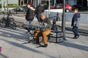 Street musician in the heart of Budapest playing using wine glasses