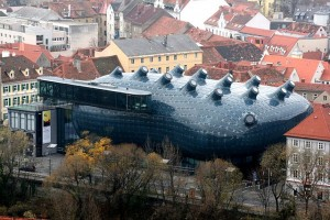 "The super futuristic ""Kunsthaus"" in Graz. It is the home of art works made after 1960. Or perhaps an unidentified submarine that can be modified to launch missiles to restore the Habsburg Monarchy. Who will be the new emperor? Arnold, Johann or Ferdinand? Perhaps Folke Tekkerhoff can write the story down"