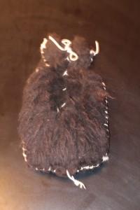 black sheepskin  hot water bottle cover (rubber bottle included) style slightly varies ($65)
