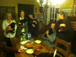 the five pups lined up with some of the guests around the dinner table