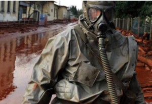 Military personnel in protective gear searching for survivals at the Ajka Aluminum chemical waste product escape disaster. The toxic sludge ultimately ended up in the Danube.